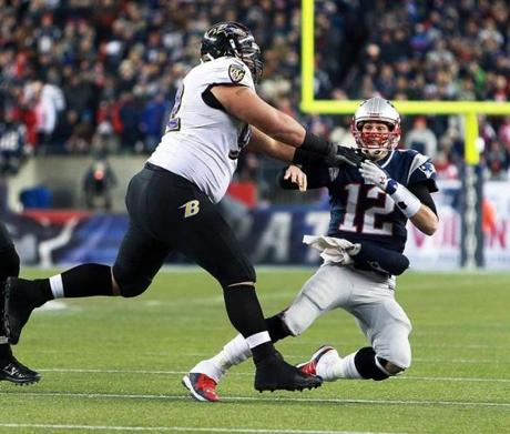 Patriots quarterback Tom Brady gets off a pass under pressure but can't complete it on fourth down late in the game.