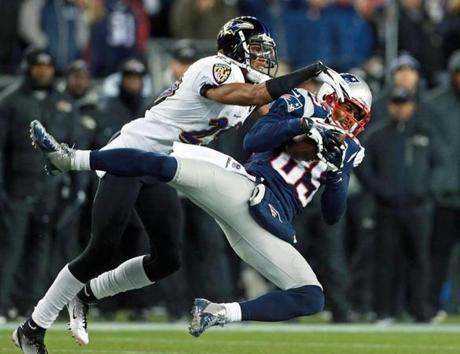 The Patriots Brandon Lloyd (85) made a nice catch of a pass from Tom Brady as the Ravens' Cary Williams defended during the AFC Championship Game at Gillette Stadium.