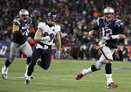 Patriots quarterback Tom Brady scrambles to get away from the Ravens defender Paul Kruger.