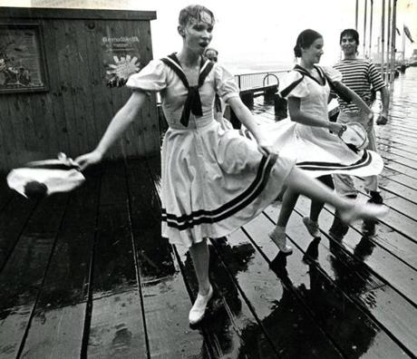 July 2, 1983: Linda Rice, Corinne Neenan, and Christopher Jones, student dancers with the Boston Ballet Ensemble, danced in the rain at the Boston Harborwalk parade. The downpour came just as the parade was ending.