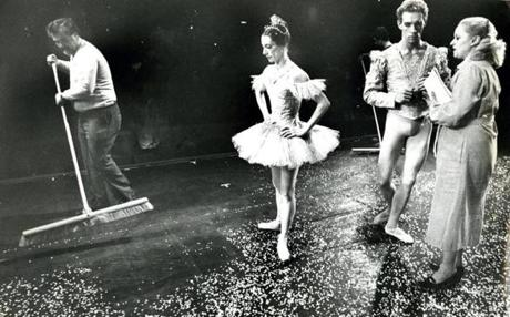 Decemebr 11, 1981: Stagehand Ray McLaughlin swept artificial snow from the stage of Boston's Metropolitan Center for the Performing Arts during dress rehearsal for Boston Ballet's production of the Nutcracker. Elaine Bauer, who danced the role of the Snow Queen, watched while Donn Edwards, who had the role of the Snow King, conversed with Violette Verdy, co-artistic director of the ballet.