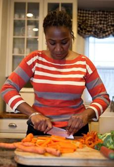Michelle Gordon of Dorchester chopped vegetables while making dinner for herself and her two teenage daughters.