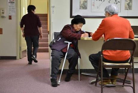 Tan Mei, a Hong Lok House tenant, met with social worker David Ko in the original building, which will be demolished.