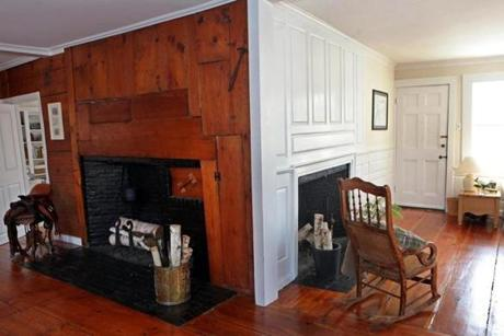 There are two fireplaces in the great room, one featuring a hanging cast-iron pot.