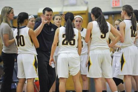 Coach Steve Solly exhorts his team during a timeout. Lexington H.S. girls' basketball v. Wakefield.
