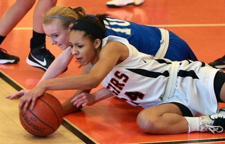Ashley Russell (10) battles for a loose ball with Newton North's Infiniti Thomas-Waheed during a game at Newton North High School.