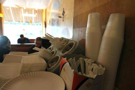 Walden Italian Kitchen, a pizza place, says it has lost money and customers have complained. It has put plastic cups out for customers to get tap water.