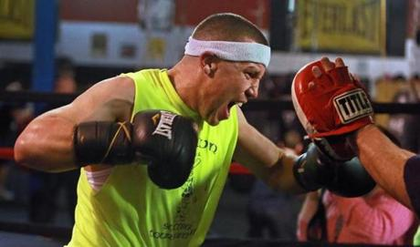 Boston police officer and professional boxer Billy Traft  worked out at the TNT gym in Braintree.
