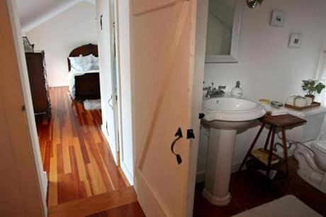 An upstairs bedroom has an adjoining bath.