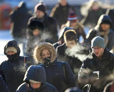 Boston was 2 degrees on the morning of Jan. 24, but the wind chill made it feel like minus 17 degrees as commuters made their way to work near  Dewey Square in Boston.