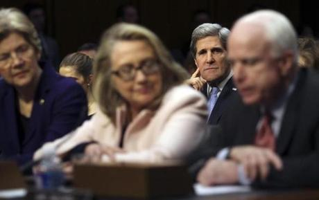 Senator John Kerry  listened as he was introduced by Senator Elizabeth Warren, Secretary of State Hillary Clinton, and Senator John McCain before the Senate Foreign Relations Committee during his confirmation hearing to become the next secretary of state.