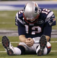 Brady was hunched over after being intercepted by the Giants in the fourth quarter of Super Bowl XLVI.