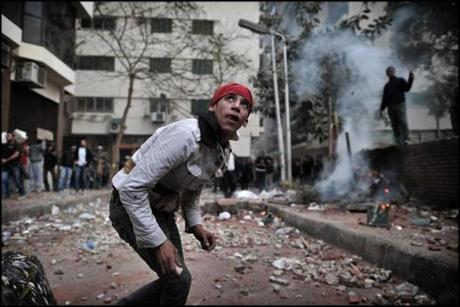 Young anti-Mubarak Egyptians threw stones at the pro-Mubarak crowd.