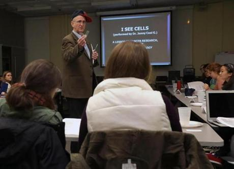 With his hat propped to one side, Professor Jonathan Garlick rapped about stem cells during a class at Tufts University.