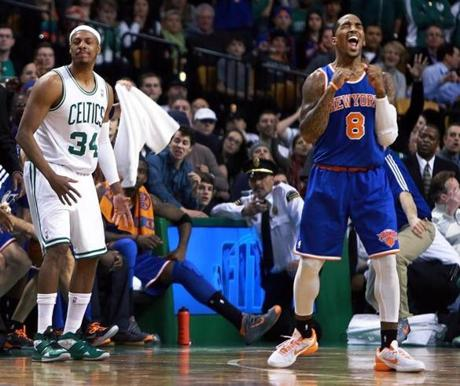 New Jersey Knicks shooting guard J.R. Smith (8) celebrated after Celtics captain Paul Pierce (34) couldn't get a handle on a pass from teammate Rajon Rondo, sealing a Boston loss late in the game at TD Garden.