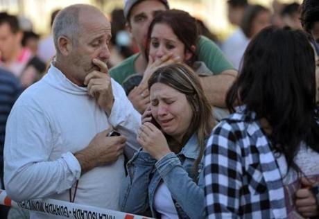 Relatives of victims cried after the fire in southern Brazil.