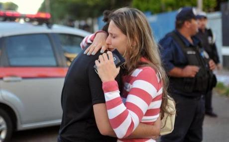 Relatives of victims embraced as they waited for information.