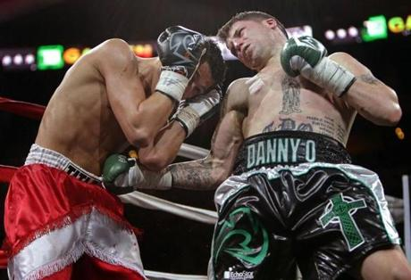 Boston, MA - 01/26/13 - TD Garden's Night at the Fight's: Danny O'Connor (Framingham, MA) at right in green trunks lands a vicious body shot as he takes on Derek Silveira (Salem, MA) in the main event of the evening. - (Barry Chin/Globe Staff), Section: Sports, Reporter: Marrapese-Burrell, Topic: 27Boxing, LOID: 5.1.426655838.
