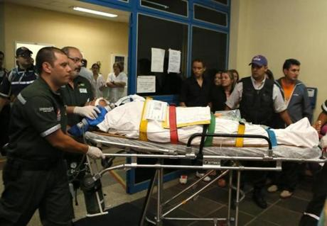 A man, who was wounded during a fire at Boate Kiss nightclub, is transferred from a hospital in Santa Maria to receive treatment at Porto Alegre hospital in the southern city of Santa Maria, 187 miles (301 km) west of the state capital Porto Alegre early January 28, 2013. The nightclub fire killed at least 232 people in Santa Maria early on Sunday when a band's pyrotechnics show set the building ablaze and fleeing partygoers stampeded toward blocked and overcrowded exits in the ensuing panic, officials said. REUTERS/Edison Vara (BRAZIL - Tags: DISASTER HEALTH)