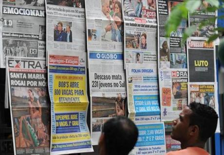 The front pages of the main Brazilian newspapers in a newsstand in Rio de Janeiro, Brazil, on January 28, 2013 have images and headlines related to the tragedy that occured on the eve in the southern city of Santa Maria, when a blaze in a disco killed 233 youngsters. A massive blaze at a nightclub in Brazil killed more than 230 people and left relatives desperately searching for loved ones as horrific accounts emerged of a tragic rush to escape the inferno. AFP PHOTO/VANDERLEI ALMEIDAVANDERLEIALMEIDA/AFP/Getty Images