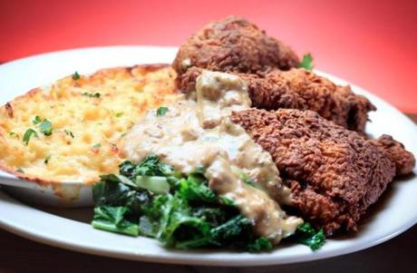 Buttermilk fried chicken, with its crackling skin, keeps the meal afloat. Both white and dark meat are coated in a rich sausage gravy, but not too much.