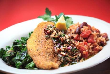 Cajun cornmeal-crusted catfish is served on a bed of redbeans and rice.