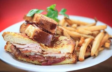 The Monte Cristo sandwich with fries is savory and warm, a good balance of its various flavors.