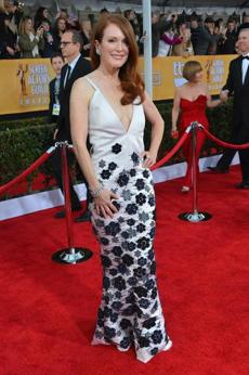 Julianne Moore This Chanel Haute Couture gown would be too flowery for the Oscar red carpet, but at the SAGAwards the floral applique detail and plunging neckline were a playful nod to the less stuffy proceedings.