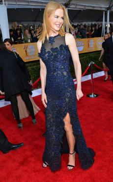 Nicole Kidman Another winner in navy, Nicole Kidman's Vivienne Westwood Couture dress offered a hint of sexiness with peek-a-boo details and a bit of leg. Her breezy styling balanced the elaborate beading.