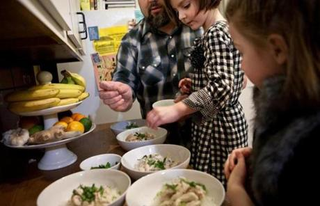 From left: John Kolodij and daughters Hollis, 4, and Charlotte, 6, helped prepare Vietnamese Pho soup.