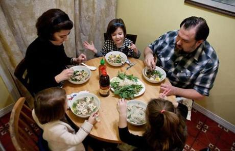 From left: Ruby, 3, Catherine, Hollis, 4, John, and Charlotte Kolodij, 6, ate the dinner they prepared together.