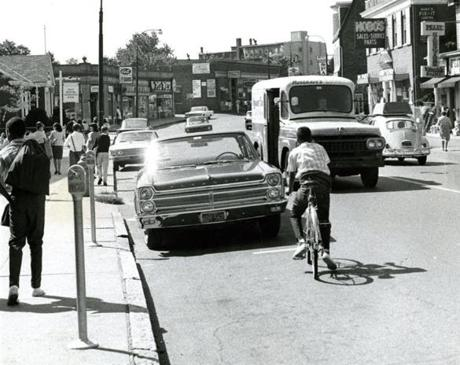 10/15/1965 - Bicyclist after getting out of Hobbs Junior High School in West Medford rides on High Street. Photo credit: Boston Globe File Photo