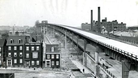 November 28, 1949: A view from the Charlestown end of the new Mystic River Bridge showed the double deck construction, with separate levels for incoming and outgoing traffic. The new Mystic River Bridge is New England's largest, longest structure of that type. It is 2700 feet longer than San Francisco's famed Golden Gate , and is twice as long as New York's Brooklyn Bridge. The War Department set 135 feet above mean tide as the necessary clearance for the big ocean-going shipping which makes much use of the Mystic River. The length of 2 1/4 miles was necessary to maintain grades of about 3 percent and not to exceed 6 percent. A shorter bridge would have plunged down on each side like a roller coaster.