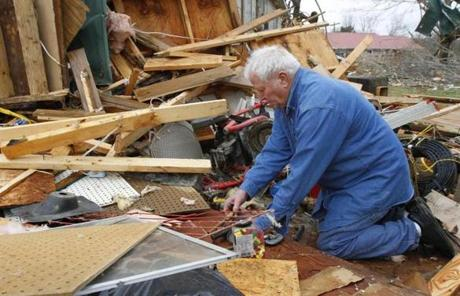 Ronnie Shanes searched through the debris of his brother's home in Coble, Tenn., early Wednesday.