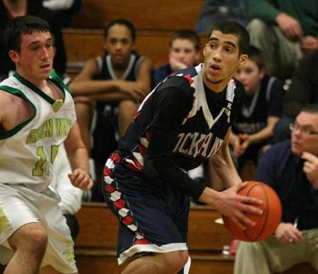 Rockland point guard Bryan Tavares looks around Abington's Ryan Mariano.