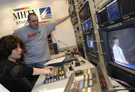 Technical director Danny Abrams, 11, of Marblehead, technical director received help from Bryan Nadeau, production coordinator at Marblehead Community Access & Media Inc., during taping.