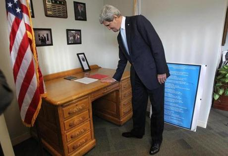 John Kerry, a former assistant district attorney in Middlesex County, checked out his old desk at the office in Woburn. The senator met with officials and supporters there.