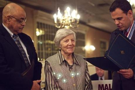 Malden's City Council president, Neal Anderson (left), and Mayor Gary Christenson honoring Dina Malgeri last month.