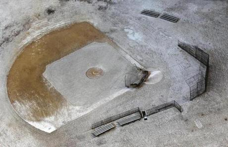 A small baseball field was dusted by snow at Boston College High School.