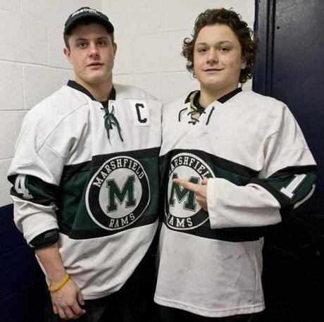 Marshfield High's Michael Carbone, left with his brother, freshman forward JoJo Carbone.