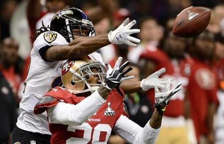 Torrey Smith  of the Ravens and Chris Culliver battled for a pass intended for Smith in the second quarter.