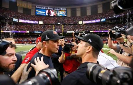 The Harbaugh brothers met on the field.