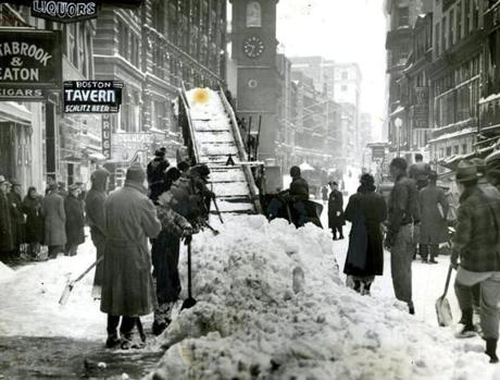 February 15, 1940: Crews were digging out on Newspaper Row. The leading story in the afternoon editions of the Valentine's Day Globe was about about the New York blizzard in which winds reached 100 miles an hour on top of the Empire State Building. As far as Boston was concerned the Weather Bureau said in the same edition, the worst part of the storm would go out to sea south of Boston. The official forecast reported: