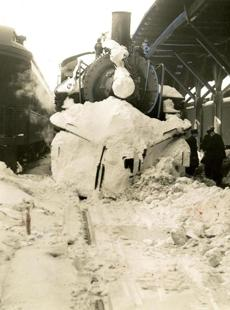 February 15, 1940: Trains were set behind by freezing and jammed switches, as well as the herculean task of digging and plowing through huge drifts on rights of way and in the yards of the main railroad lines into Boston. Emergency crews worked all day and night with flame throwers, oil lamps and bonfires for the huge task of clearing the way for trains.
