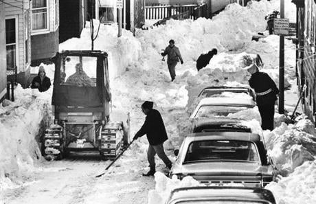 People worked to clear the Pleasant Street in Charlestown.