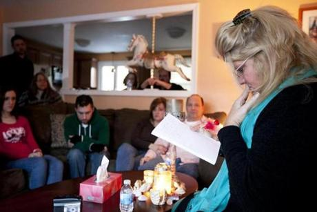 Johnston, RI - 1/27/2013 - Lisa Powers (cq), right, the medium, speaks with spirits while family friends of Dave Kane (cq) and Joanne O'Neill (cq) listen. Dave Kane and his wife Joanne O'Neill invite a medium, Lisa Powers, to communicate with their son Nick O'Neill to celebrate what would be his 28th birthday at their home in Johnston, RI on Sunday, January 27, 2013. Nick died in the Station night club fire in 2003. (Yoon S. Byun/Globe Staff) Slug: 17nightclub Reporter: arsenault LOID: 5.1.450736470