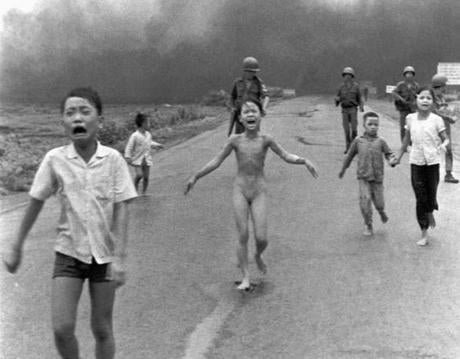 Kim Phuc (center) suffered burns from a napalm bombing in 1972 during the Vietnam War that left her disfigured. She had ripped off her burning clothes while fleeing.