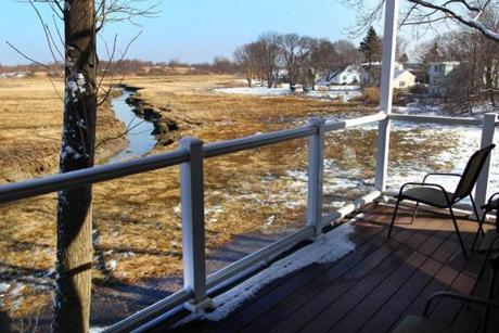 The deck overlooks the marsh.