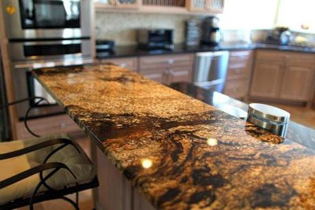 The breakfast counter is made of granite.
