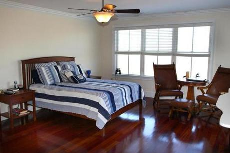 On the second floor, the master bedroom has a gas fireplace, walk-in closet, its own bath and deck.